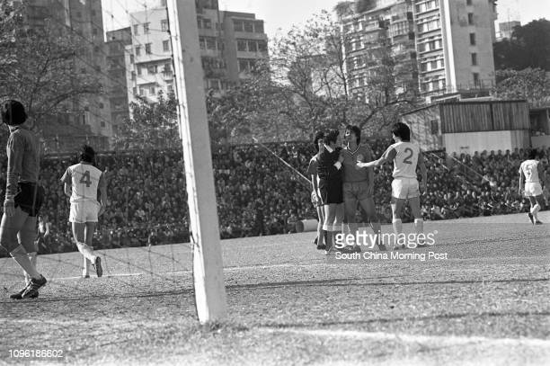Players of Happy Valley and Eastern query a referee decision during their Senior Shield clash at the Police Ground Stadium Happy Valley won 10 27NOV77