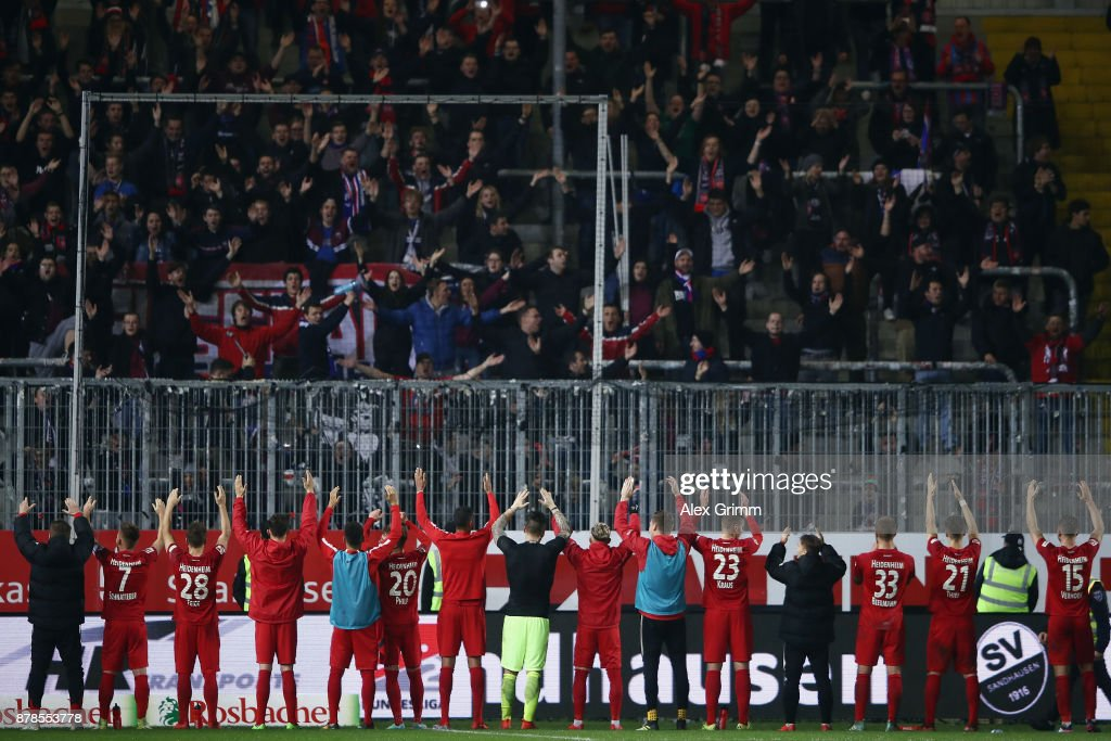 Players of Heidenheim celebrate with the fans after the Second Bundesliga match between SV Sandhausen and 1. FC Heidenheim 1846 at BWT-Stadion am Hardtwald on November 24, 2017 in Sandhausen, Germany.