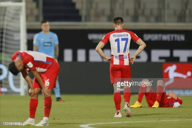Players of Heidenheim react after the Bundesliga playoff second leg match between 1. FC Heidenheim and Werder Bremen at Voith-Arena on July 6, 2020...