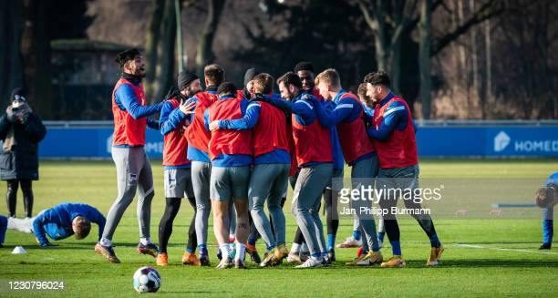 Players of Hertha BSC celebrate during the training session at Schenckendorffplatz on January 26, 2021 in Berlin, Germany.