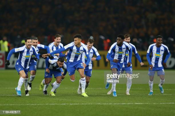 Players of Hertha BSC celebrate victory in the penalty shootout during the DFB Cup second round match between Hertha BSC and Dynamo Dresden at...