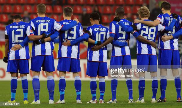 Players of Hertha BSC stand in silence to commemorate the victims of the Japan earthquake before the second Bundesliga match between FC Ingolstadt...