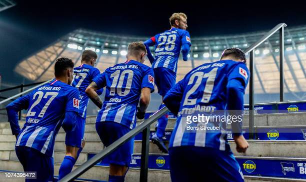 Players of Hertha enter the pitch for the second half during the Bundesliga match between Hertha BSC and FC Augsburg at Olympiastadion on December 18...