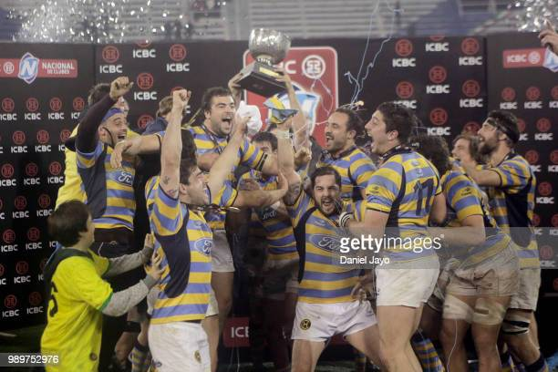 Players of Hindu celebrate with the trophy at the end of the final match between Hindu and Newman as part of Argentina National Rugby Championship...