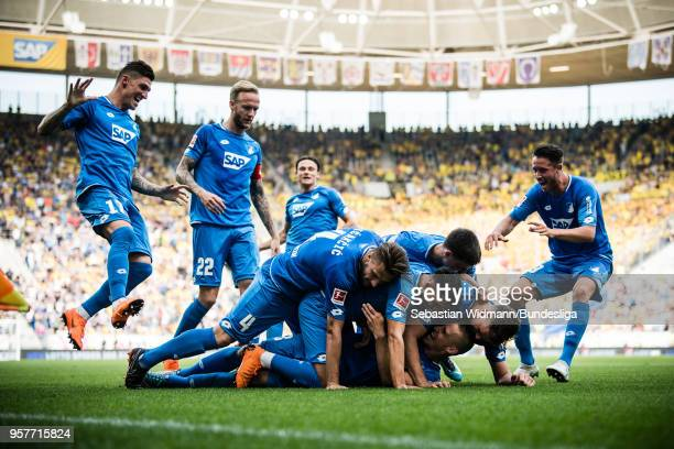 Players of Hoffenheim celebrate their teams third goal during the Bundesliga match between TSG 1899 Hoffenheim and Borussia Dortmund at Wirsol...