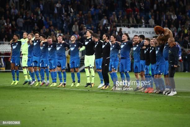 Players of Hoffenheim jump in joy as they celebrate with their supporters after the Bundesliga match between TSG 1899 Hoffenheim and FC Bayern...