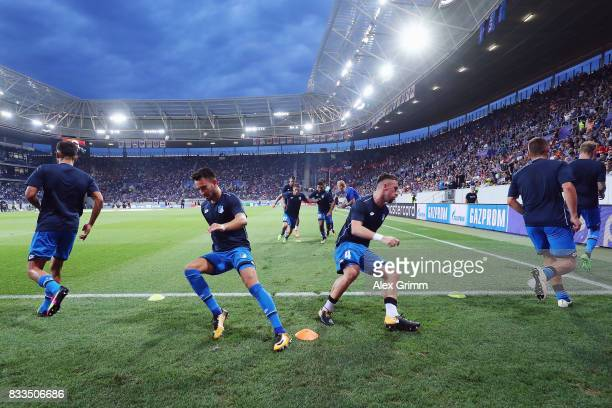Players of Hoffenheim warm up prior to the UEFA Champions League Qualifying PlayOffs Round First Leg match between 1899 Hoffenheim and Liverpool FC...
