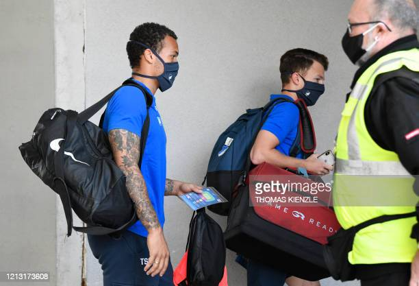 Players of Hoffenheim wear face masks as they arrive at the stadium prior the German first division Bundesliga football match TSG 1899 Hoffenheim v...