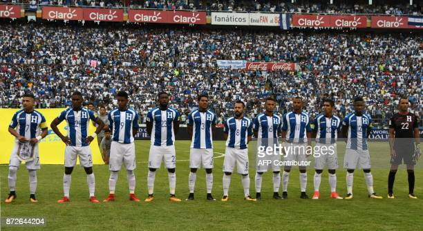 Players of Honduras listen to their national anthem efore the start of the first leg football match of their 2018 World Cup qualifying playoff...