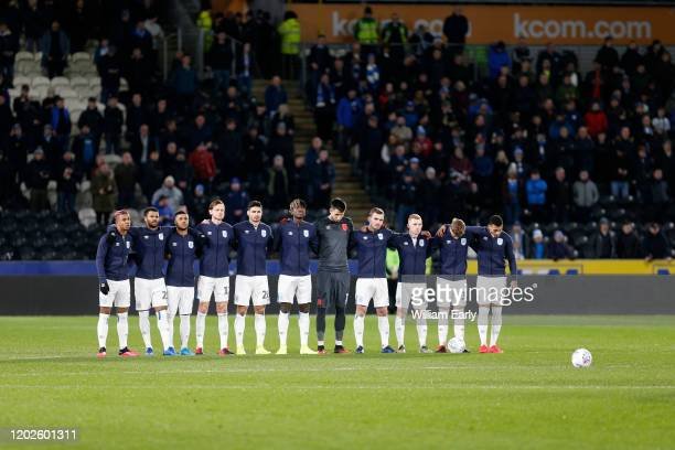 Players of Huddersfield Town and Hull City pay their respects to Jordan Sinnott during the Sky Bet Championship match between Hull City and...