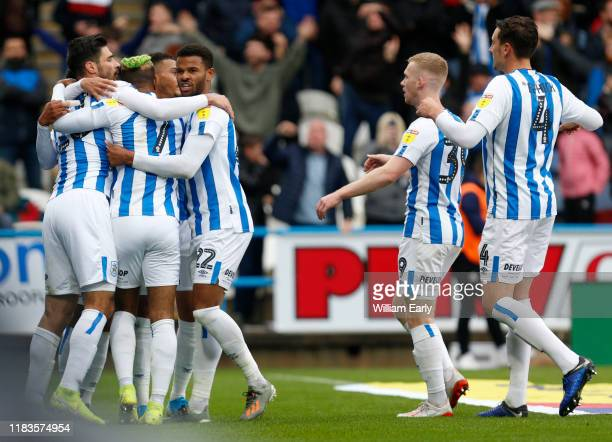 Players of Huddersfield Town celebrate during the Sky Bet Championship match between Huddersfield Town and Barnsley at John Smith's Stadium on...