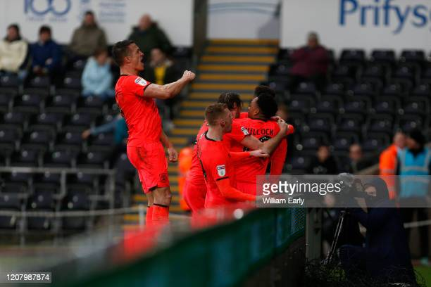 Players of Huddersfield Town celebrate the equaliser during the Sky Bet Championship match between Swansea City and Huddersfield Town at Liberty...