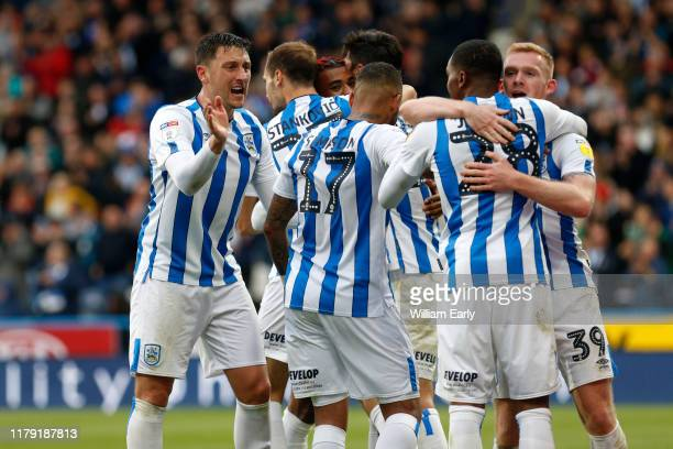 players of Huddersfield Town celebrate their third goal of the game during the Sky Bet Championship match between Huddersfield Town and Hull City at...