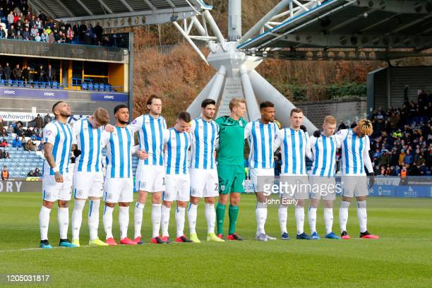 players of Huddersfield Town pay their respects for Jordan Sinnott during the Sky Bet Championship match between Huddersfield Town and Queens Park...