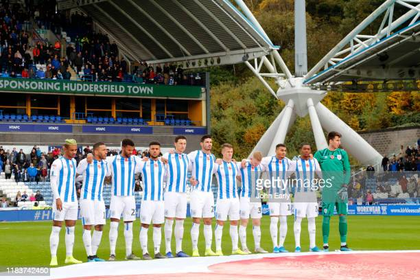 Players of Huddersfield Town show their respect for remembrance day during the Sky Bet Championship match between Huddersfield Town and Barnsley at...