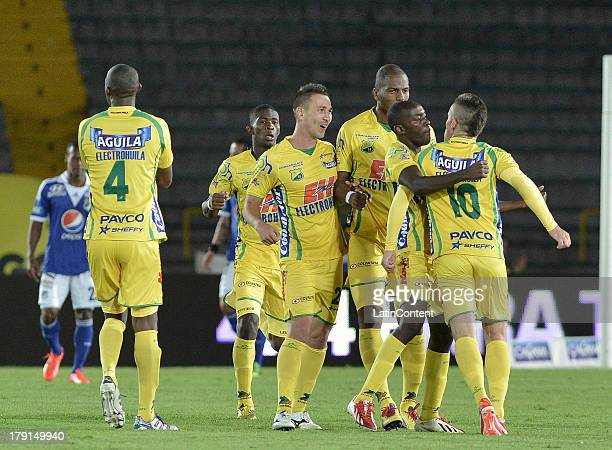 Players of Huila celebrate a goal against Millonarios during a match between Millonarios and Atletico Huila as part of the Liga Postobon II 2013...