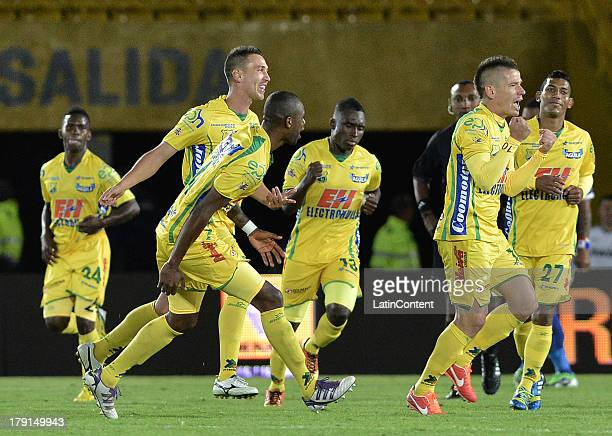Players of Huila celebrates a goal against Millonarios during a match between Millonarios and Atletico Huila as part of the Liga Postobon II 2013...