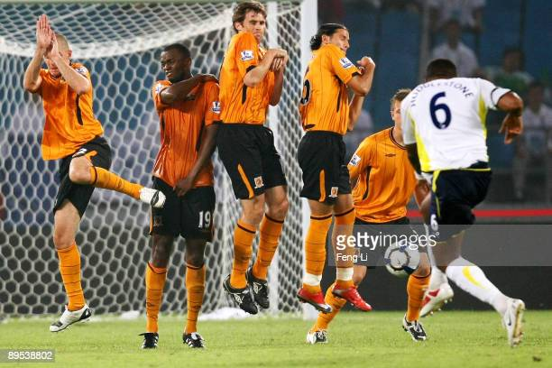 Players of Hull City jump in the wall as Tom Huddlestone of Tottenham strikes a freekick during the Barclays Asia Trophy preseason friendly match...