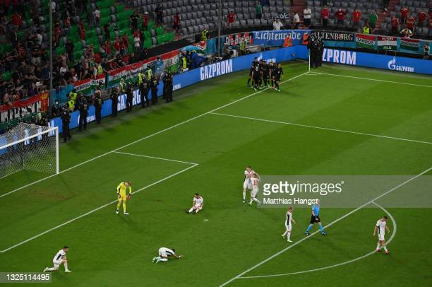 Players of Hungary look dejected as Leon Goretzka of Germany celebrates with team mates after scoring their side's second goal during the UEFA Euro...