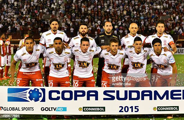 Players of Huracan pose for a team photo prior to a first leg final match between Huracan and Independiente Santa Fe as part of Copa Sudamericana...