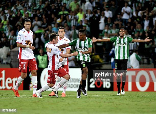 Players of Huracan react after missing the second leg match between Atletico Nacional and Huracan as part of round of 16 of Copa Bridgestone...