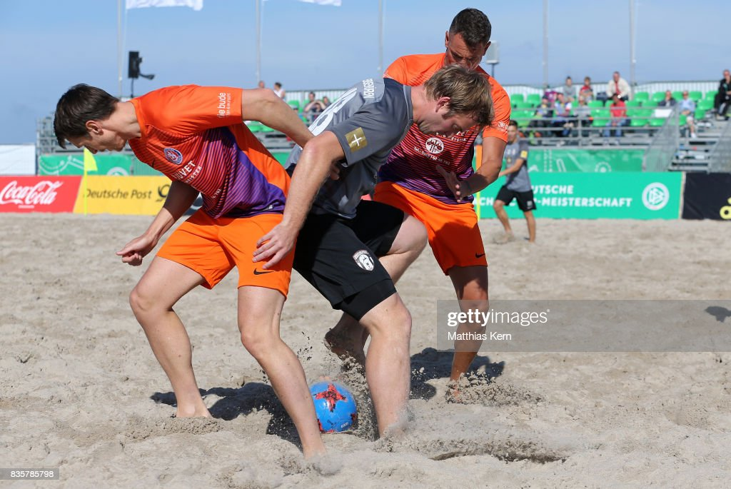 Players of Ibbenbuerener BSC and Wuppertaler SV battle for the ball on day 2 of the 2017 German Beach Soccer Championship on August 20, 2017 in Warnemunde, Germany.