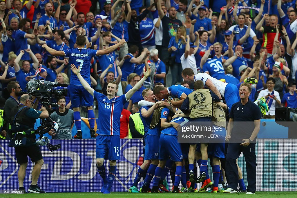 Players of Iceland celebrate after the UEFA EURO 2016 Group F match between Iceland and Austria at Stade de France on June 22, 2016 in Paris, France.