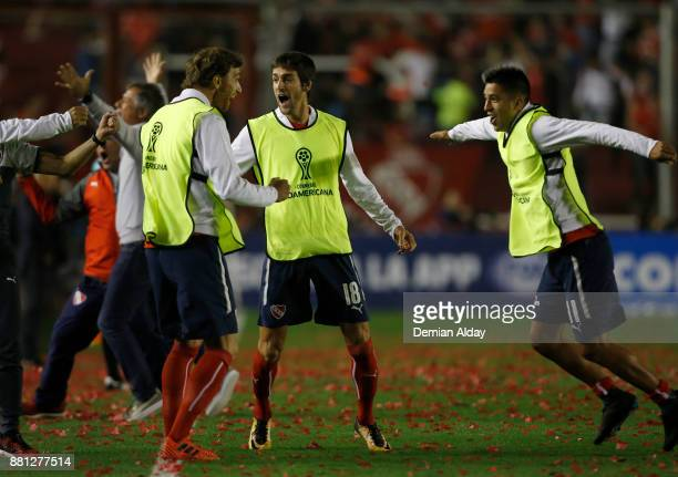 Players of Independiente celebrate after teammate Ezequiel Barco scored the first goal of his team during a second leg match between Independiente...