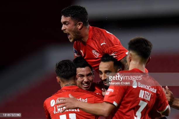 Players of Independiente celebrate the first goal of their team after an own goal by Thonny Anderson of Bahia during a match between Independiente...