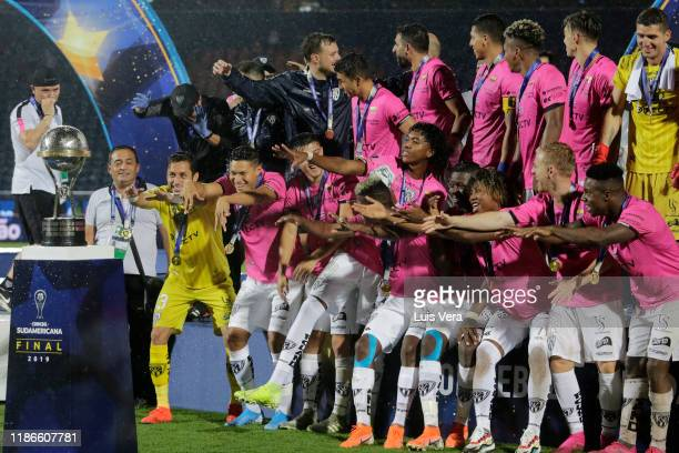 Players of Independiente del Valle celebrate with the trophy after winning the final of Copa CONMEBOL Sudamericana 2019 between Colon and...