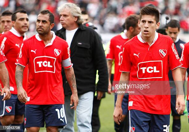 Players of Independiente lament after a match between River Plate and Independiente as part of the Torneo Final 2013 at the Monumental Vespusio...