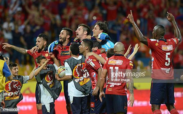 Players of Independiente Medellin celebrate after winning a semifinal match between Medellin and Deportes Tolima as part of the Liga Águila I 2015 at...