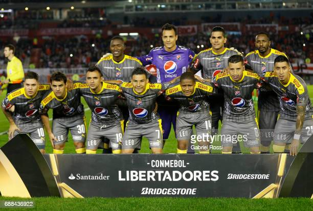 Players of Independiente Medellin pose for a photo prior the group stage match between River Plate and Independiente Medellin as part of Copa...