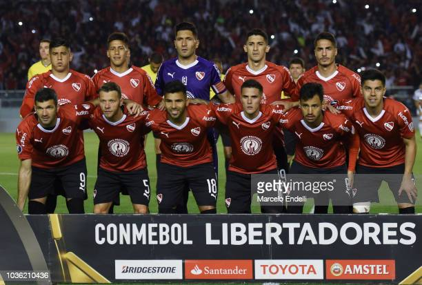 Players of Independiente pose for a team photo prior to a quarter final first leg match between Independiente and River Plate as part of Copa...