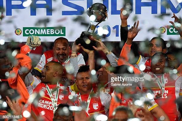 Players of Independiente Santa Fe lift the trophy to celebrate after winning the Copa Sudamericana final match between Independiente Santa Fe and...