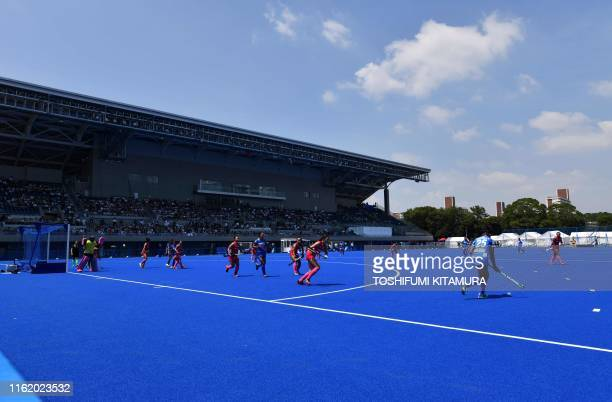 Players of India and Japan compete during a women's pool A qualification match between India and Japan at the Ready Steady Tokyo hockey tournament a...