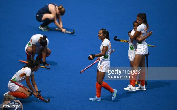 Players of India celebrate after defeating Ireland 1-0 in their women's pool A match of the Tokyo 2020 Olympic Games field hockey competition, at the...