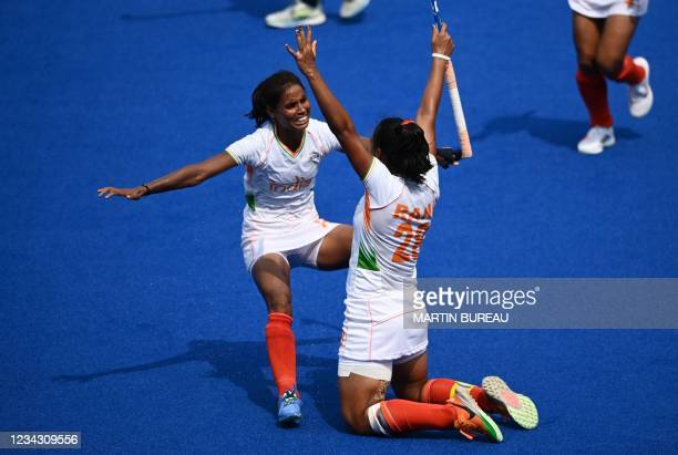 Players of India celebrate after scoring against Ireland during their women's pool A match of the Tokyo 2020 Olympic Games field hockey competition,...