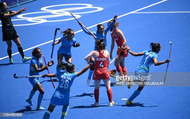 Players of India celebrate after teammate Gurjit Kaur scored the second goal against Britain during the women's bronze medal match of the Tokyo 2020...