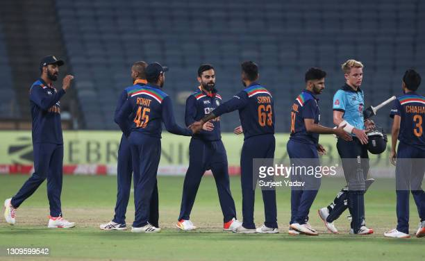 Players of India interact with Sam Curran of England following the 3rd One Day International match between India and England at MCA Stadium on March...