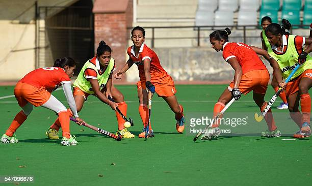 Players of Indian Women's Hockey team play during a training session at National Stadium on July 13 2016 in New Delhi India