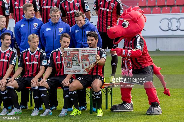 Players of Ingolstadt and mascot 'Schanzi' pretend reading a handout of Ingolstadt´s sponsor 'Media Markt' during the FC Ingolstadt 04 team...