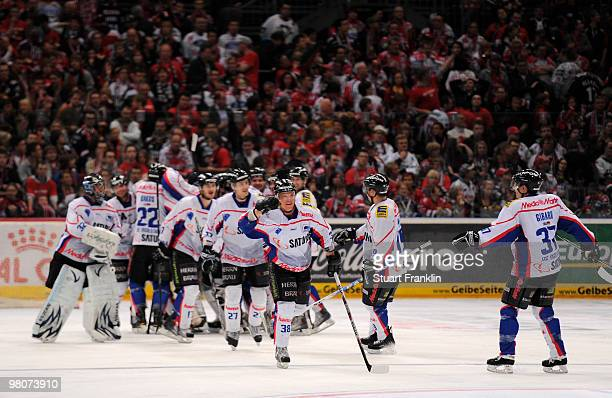 Players of Ingolstadt celebrate their teams win at the end of the DEL playoff match between Koelner Haie and ERC Ingolstadt on March 26 2010 in...