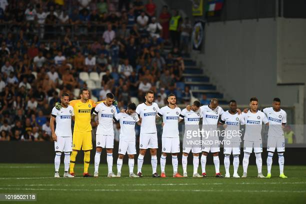 Players of Inter Milan hold a minute of silence for the victims of Genoa's Morandi bridge collapse, prior to the Italian Serie A football match...
