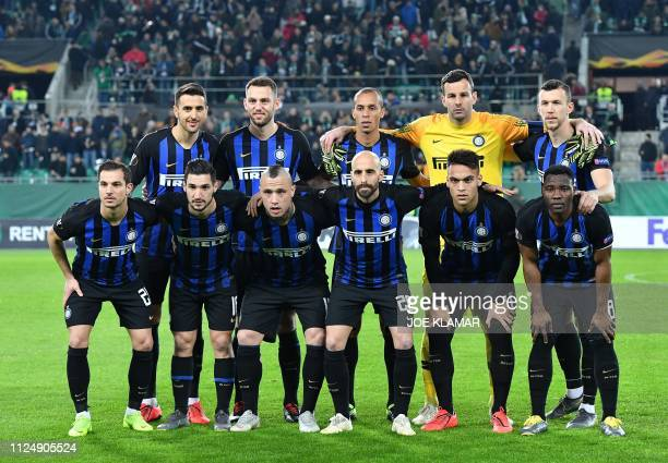 Players of Inter Milan players pose for the team photo prior to the UEFA Europa League round of 32 firstleg football match between Rapid Wien and...