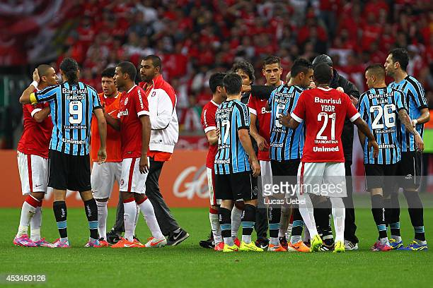 Players of Internacional and Gremio argue after the match between Internacional and Gremio as part of Brasileirao Series A 2014, at Estadio Beira-Rio...