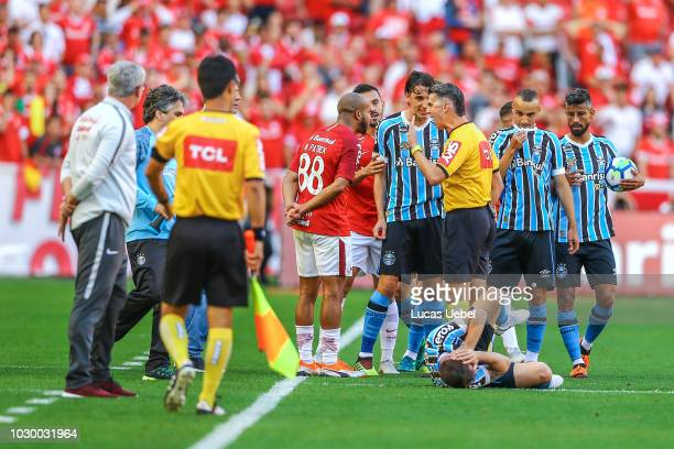 Players of Internacional and Gremio argue during the match between Internacional and Gremio as part of Brasileirao Series A 2018 at BeiraRio Stadium...