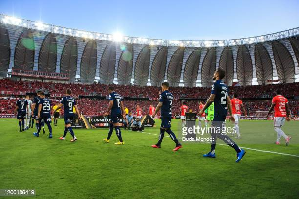 Players of Internacional and Universidad de Chile enter to the field before a match between Internacional and Universidad de Chile as part of Copa...