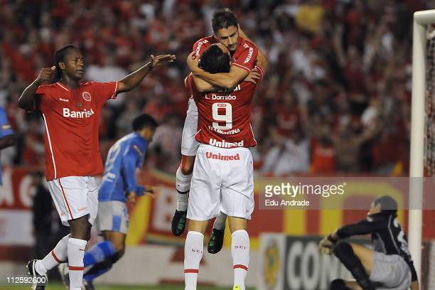 Players of Internacional celebrate a goal scored by Rafael Sobis during the match against Emelec as part of the Santander Libertadores Cup 2011 at...