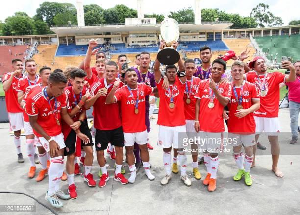 Players of Internacional celebrate after winning the final match against Gremio for the Copa Sao Paulo de Futebol Junior Final at Pacaembu Stadium on...